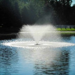 large lake with fountain aeration filtration system